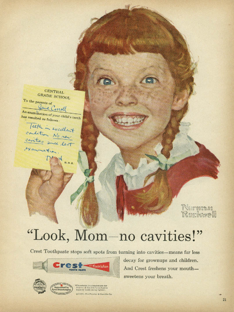 Redhead girl with freckles and pigtails showing a note from Central Grade School To the parents of Janie Carroll, An examination of your child's teeth has resulted as follows: Teeth in excellent condition No new cavities since last examination. Janie says 'Look Mom no new cavities' in this 1950s magazine ad from Crest and Norman Rockwell.