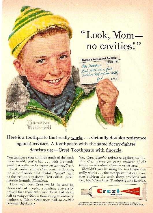 Blond boy in a yellow and green knit cap holds up a note. Ad headline says Here is a toothpaste that really works ... virtually doubles resistance against cavities. A toothpaste with the same decay-fighter dentists use - Crest toothpaste with fluoride.