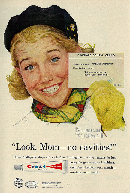 Patricia Patterson portrait by Norman Rockwell shows her big smile and a note from Pinedale Dental Clinic - not one new cavity since last checkup. Slogan for Crest's fluoristan toothpaste: Look Mom no cavities.