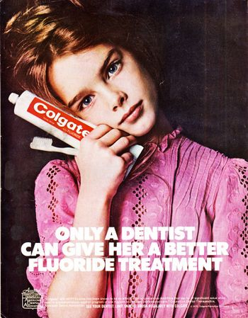 Ad featuring 10-year-old Brooke Shields holding a tube of Colgate fluoride toothpaste - copy reads Only a dentist can give her a better fluoride treatment