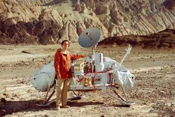 Carl Sagan with a model of NASA Viking Lander in desert Death Valley