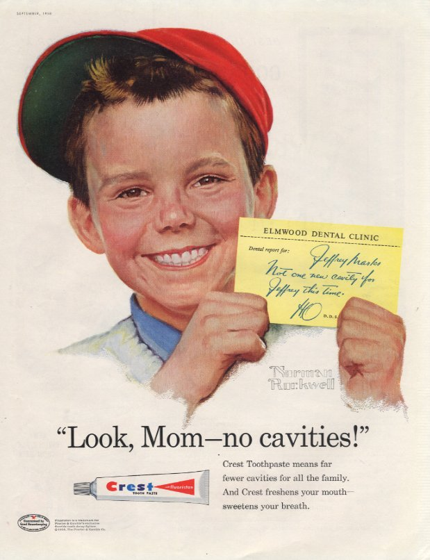 Advertisement for Crest, the first company to put fluoride in toothpaste, shows Norman Rockwell painting of Jeffrey Marks, a young boy wearing a red cap, smiling and holding a note from Elmwood Dental Clinic and featuring the slogan Look, Mom, no cavities.