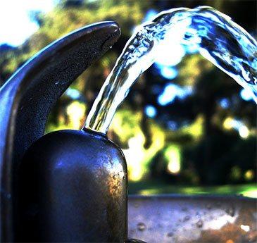 Fluoridated drinking water fountain running