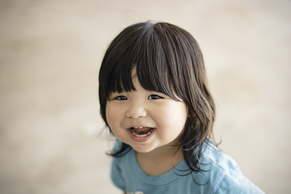 Smiling child who only needs fluoride supplements if no fluoridated water