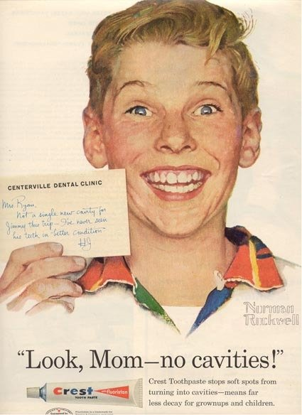Ad for Crest's first fluoride toothpaste featuring a portrait of kid Jimmy Ryan smiling and holding up a note from the dentist