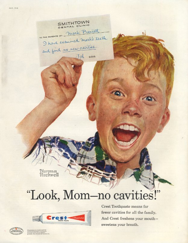 Norman Rockwell portrait of child Mark Barnett has a big excited smile and holds up a note from Smithtown Dental Clinic with a note from the dentist saying 'I have examined Mark's teeth and find no new cavities.' Bottom of ad for Crest toothpaste features the slogan 'Look Mom no cavities,' an image of a tube of Crest toothpaste, and more ad copy.