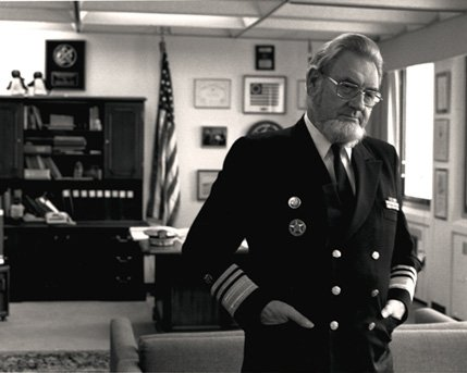 A black and white photo of Surgeon General Koop in his office in uniform