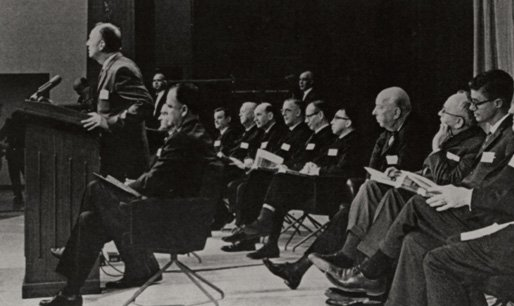 Historic black and white photo of the press conference at which Surgeon General Luther Terry announced the release of the report on smoking