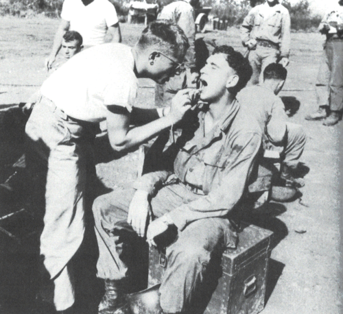 Picture of a dental exam being conducted in the field during World War 2