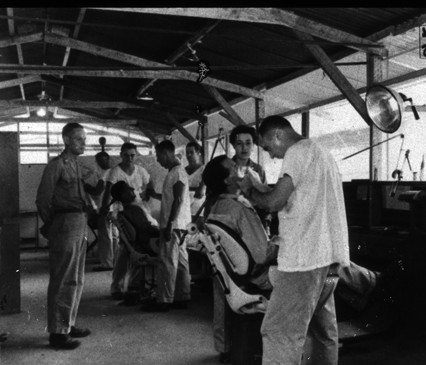 Dental exams in barracks-like building during World War 2
